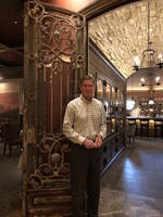 Sandy Cutler, Owner of Cru Uncorked, A pair of antique French gates, provenance unknown, circa 1890 leading to the Wine Corridor